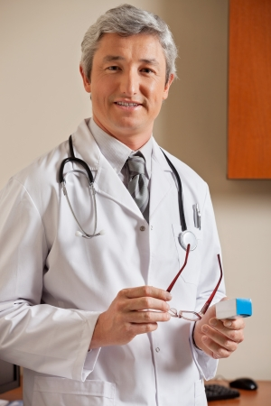 Doctor Holding Glasses And Medicine Box Stock Photo - 17238686