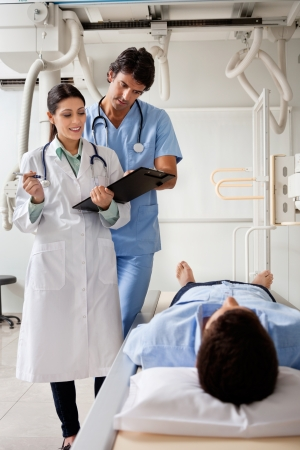 Medical Professionals Communicating With Patient Stock Photo - 17238477