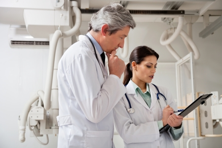 lab tech: Radiologists In A Discussion Stock Photo