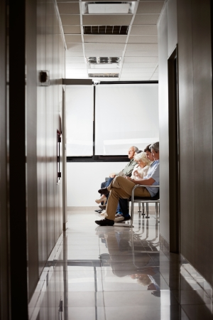 healthcare visitor: People In Hospital s Waiting Area Stock Photo