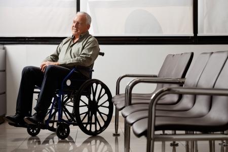 man waiting: Disabled Senior Man Looking Away