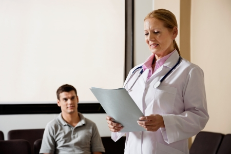 Female Doctor Looking At File Stock Photo - 17238472