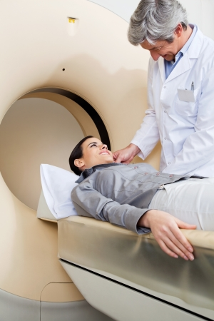 Female Going Through CT Scan Test photo