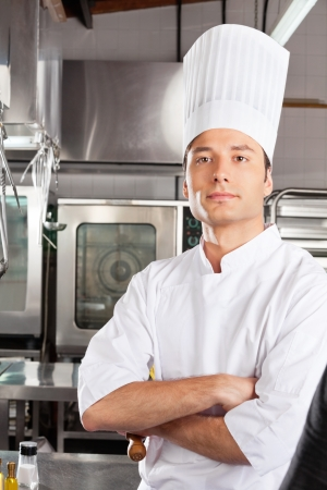 commercial kitchen: Chef Standing With Arms Crossed