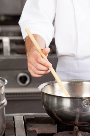 stirring: Male Chef preparing Food