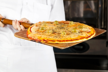 convection: Chef Holding Pizza On Shovel