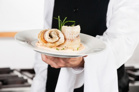 Waiter Presenting Salmon Roll Stock Photo - 18005877