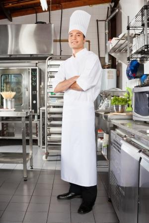 hotel kitchen: Confident Male Chef In Kitchen