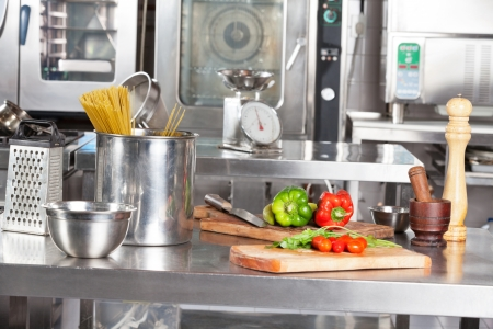 industrial objects equipment: Spaghetti Pasta And Bell Peppers On Kitchen Counter