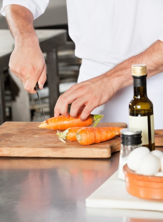 Male Chef Cutting Carrots photo