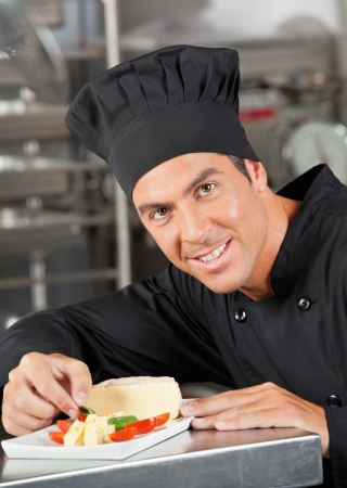 Happy Chef Garnishing Dish Stock Photo - 18029437
