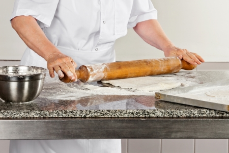 Female Chef Rolling Dough photo