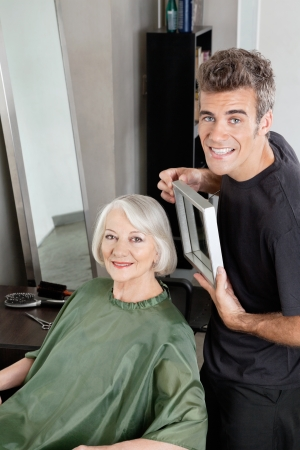 Customer With Hairdresser Holding Mirror photo