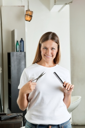 Hairdresser Holding Comb And Scissors photo