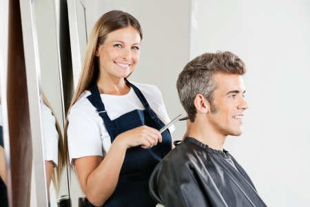 Hairstylist Giving Haircut To Customer photo