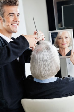 Hairdresser Cutting Client s Hair photo