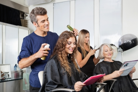 Hairdressers Setting Up Client s Hair In Salon photo