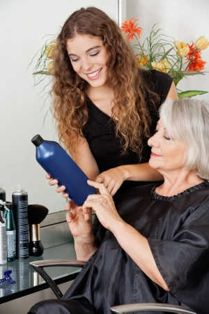Hairdresser Advising Hair Color To Customer photo