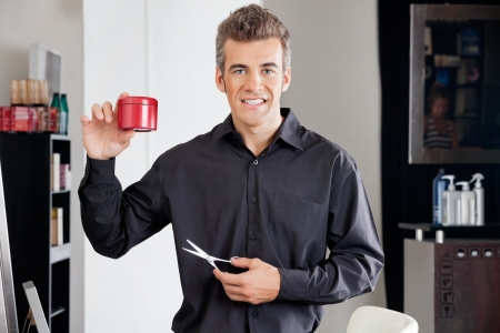Hairstylist With Scissors Presenting Hairgel Bottle Stock Photo - 18068550