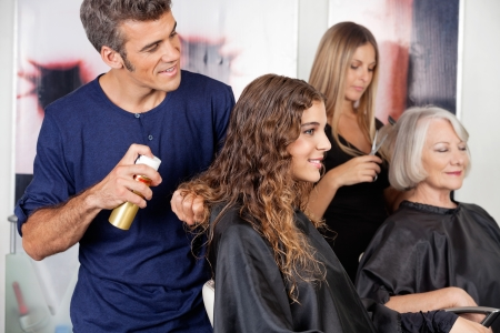 hair stylist: Hairdressers Setting Up Client s Hair Stock Photo