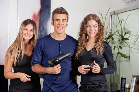 Happy Hairstyling Team At Beauty Parlor photo