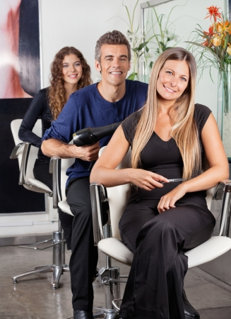 Confident Team Of Hairstylists At Beauty Parlor photo