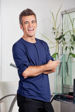 Male Hairstylist Standing With Arms Crossed In Salon Stock Photo - 18068554