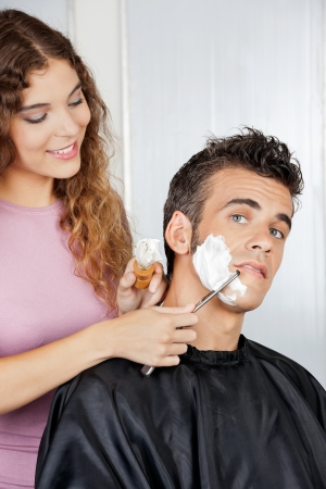 Man Getting A Shave From Female Barber photo
