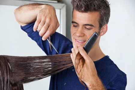 Hairdresser Cutting Client s Hair Stock Photo - 18068580