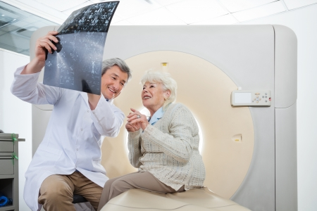 Radiologist With Patient Looking At CT Scan Results photo
