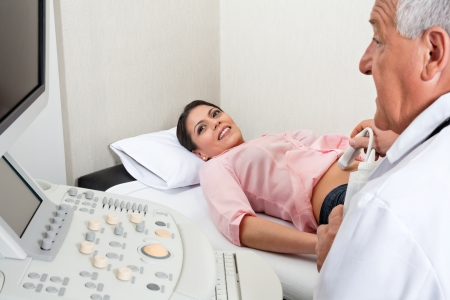 Female Going Through Abdomen Ultrasound Stock Photo - 18091682