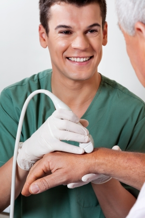 Technician Scanning Male Patient s Hand Stock Photo - 18091709