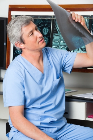 Radiologist Analyzing Patient s X-ray photo