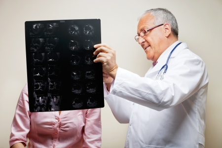 Senior Radiologist Holding X-ray photo