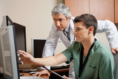 residents: Doctor And Technician Working Together