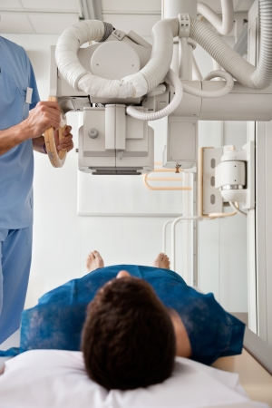 radiographic: Technician Taking Patient s X-ray Stock Photo