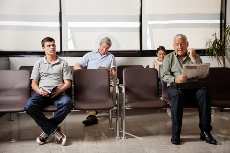 reception room: People Waiting In Hospital Lobby