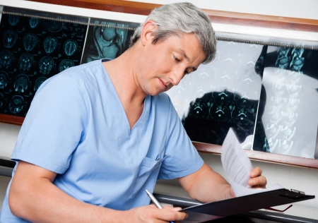 Medical Professional Going Through Document photo