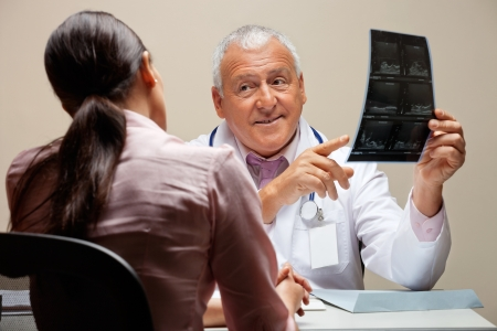 Radiologist Showing X-ray To Patient Stock Photo - 18117870