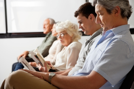 healthcare visitor: Patients Waiting In Lobby Stock Photo