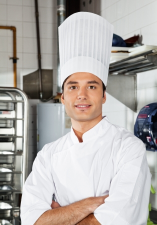 Young Chef With Arms Crossed In Kitchen photo