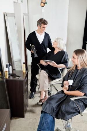 Hairdresser With Client s In Salon Stock Photo - 18137378