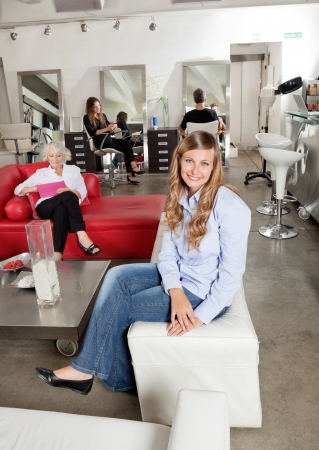 Client Smiling With Customers In Background photo