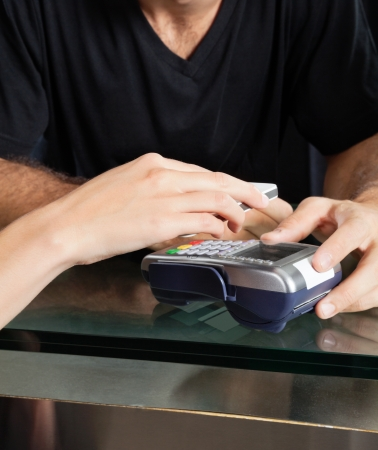 Customer Paying With Mobilephone Over Electronic Reader At Salon Stock Photo - 18136810