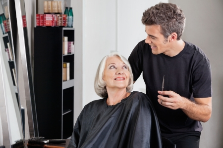 beauty parlor: Female Client And Hairdresser Looking At Each Other