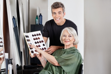Client With Hairstylist Holding Color Catalog photo