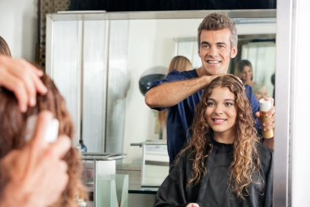 Hairstylist Setting Client s Hair While Looking At Mirror