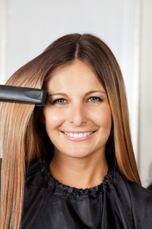 Woman Straightening Hair photo