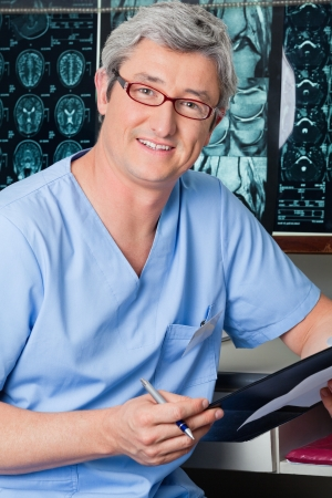 Male Doctor Holding Clipboard Stock Photo - 18137068