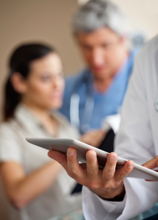 patient and doctor: Doctor Using Digital Tablet